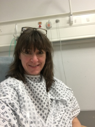 Rocking the two gown and paper knicker look while I wait for surgery.